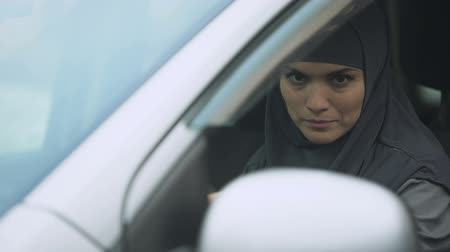 engedély : Woman in traditional Muslim scarf going to meeting, getting driving license