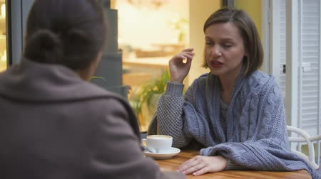 hot news : Young unhappy female discussing problems with her best friend trustful relations Stock Footage