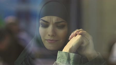 refugee crisis : Muslim female immigrant crying, discrimination of refugees, migration crisis