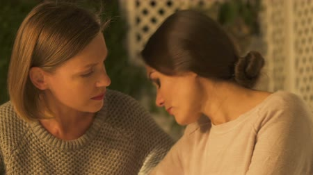 bereavement : Two sisters supporting each other in grief, dealing with family loss, closeup Stock Footage