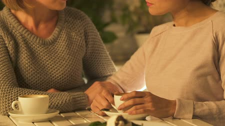bereavement : Women chatting over cup of coffee, supporting in difficulty, female friendship