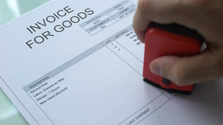 gerek : Invoice for goods past due, hand stamping seal on commercial document, business Stok Video
