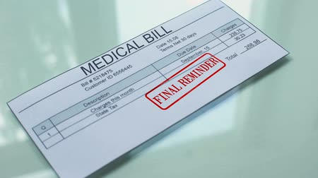 политика : Medical bill final reminder, hand stamping seal on document, payment, tariff