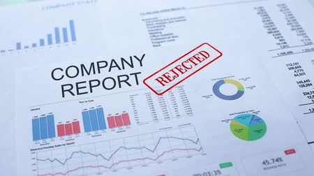 semanal : Company report rejected, hand stamping seal on official document, statistics Stock Footage