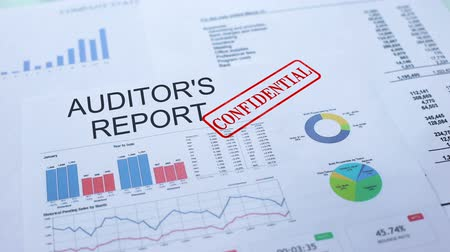 auditing : Auditors report confidential, stamping seal on official document, statistics Stock Footage