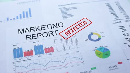 semanal : Marketing report rejected, hand stamping seal on official document, statistics Vídeos