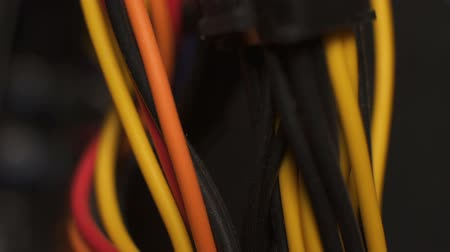 telecomunicações : Isolated multicolored cable interconnecting server details, power supplies