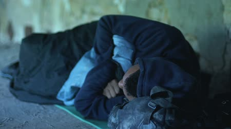 cruelty : Homeless afro-american boy sleeping in underground pass, misery and poverty