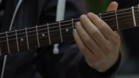 akord : Musician guitarist playing chords on electric guitar close up, music hobby
