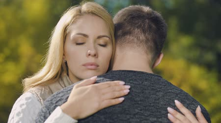 wrzesień : Upset couple hugging, looking wistful, fatal disease diagnosis, support and care Wideo