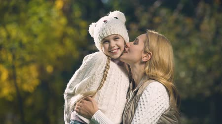 anne : Mother kissing daughter, sweet moments together, happy childhood, motherhood