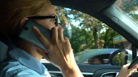 emperrado : Successful business lady stuck in traffic jam, answering on phone call, traffic