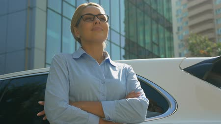 self motivated : Attractive business woman looking ahead into bright future, successful career Stock Footage
