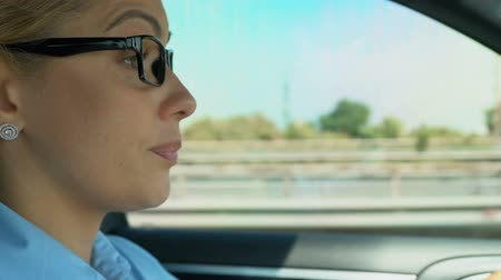 deprivation : Woman puts on and takes off glasses while driving, blurred vision, asthenopia