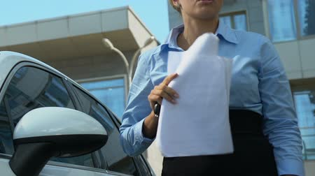 unlucky : Businesslady getting out of car dropping phone and throwing papers, hateful work