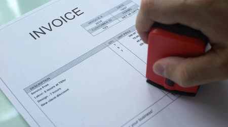 necessidade : Invoice past due, worker hand stamping seal on commercial document, business Stock Footage