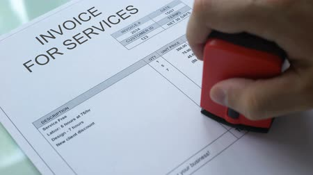 дебет : Invoice for service debt, hand stamping seal on commercial document, business Стоковые видеозаписи
