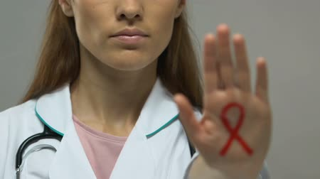 sida : Red ribbon painted on doctor hand, stop AIDS epidemic, prevention and control