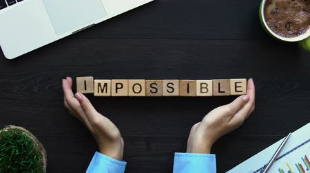 attitude : Impossible to possible, hand putting word of cubes, motivation for development