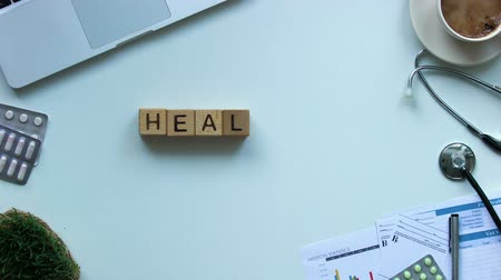 ambulancias : Healthcare word made of cubes on doctors table, disease treatment, diagnostics