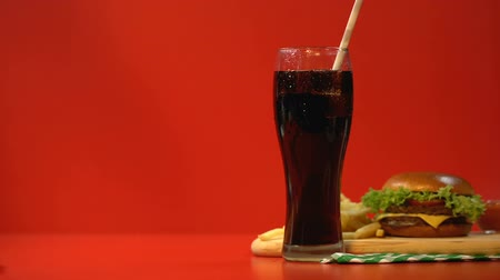 sweetened : Consumer drinking soda with straw, sweetened beverage, risk of diabetes obesity
