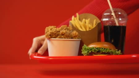 sweetened : Person taking away set of fast food meals, consumption concept, unhealthy eating