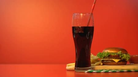 sweetened : Person drinking soda with straw, fast food lunch, unhealthy high calorie meal Stock Footage