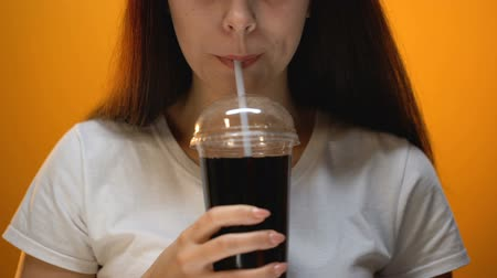 glicose : Happy girl drinking soda, enjoying sweetened drink, sugar addiction concept