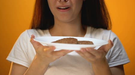 unpleasant smell : Woman smelling spoiled cutlets, stinky food, outdated meat and risk of poisoning Stock Footage
