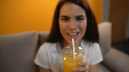 fructose : POV of male giving orange juice to cheerful girl, healthy vitamin drink, diet Stock Footage