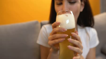 craft beer : POV of friend giving craft beer to cheerful girl, refreshing alcoholic drink Stock Footage
