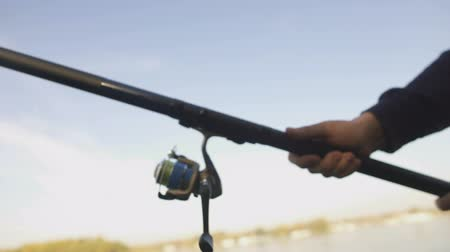 free throw : Close up of fishing reel, man catching fish with spinning rod in hand, gear Stock Footage