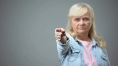 disapprove : Unhappy elderly female showing away gesture to camera, displeased with policy Stock Footage