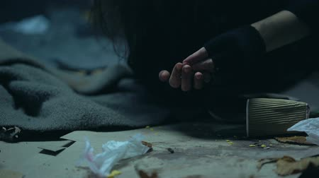 csavargó : Homeless dirty woman with trembling hands counting coins from cup, beggar, alms