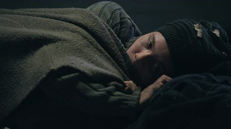 refugee crisis : Freezing crying homeless lady shivering with cold, taking cover, social problems Stock Footage
