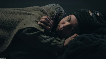 csavargó : Crying refugee taking cover, missing home and looking for shelter, poverty Stock mozgókép