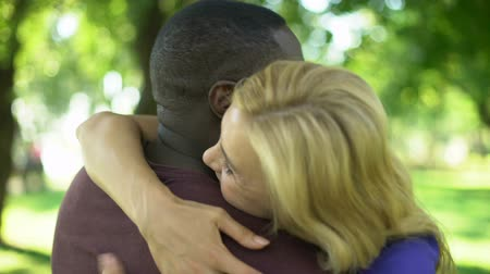 lasting : Female emotionally hugs interracial boyfriend, long lasting love relationship