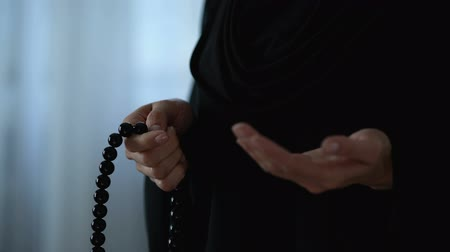 cerimonial : Muslim woman praying with islamic beads in hand, religious meditation, worship
