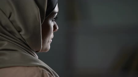 abused : Unhappy arab woman in hijab close-up, pessimistic mood, sorrow, melancholy