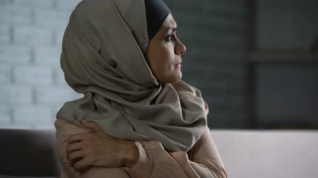 smutny : Abused arab female thinking of troubles, desperate woman worrying, anxiety