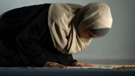 duch Święty : Young female in hijab praying on mat, asking god forgiveness, religious ritual Wideo
