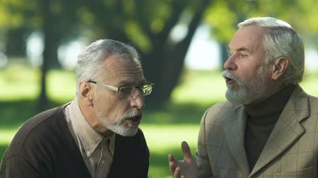 misunderstood : Two grandfathers discussing political news, friends misunderstanding, talking