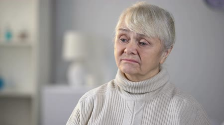homesick : Unhappy senior woman in nursing home feeling depressed and forgotten, loneliness Stock Footage