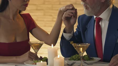 koketa : Egoistic lady having dinner with old rich man, concept of relationship for money