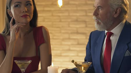 иностранец : Young lady having dinner with old millionaire, marriage of convenience concept Стоковые видеозаписи
