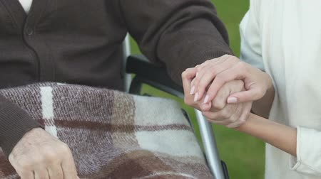 philanthropy : Woman holding hand of patient in wheelchair, volunteer program, charity concept