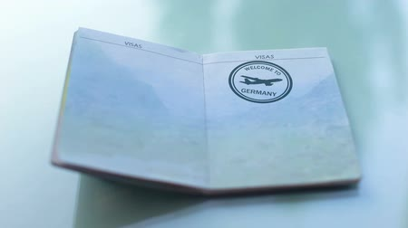 иностранец : Welcome to Germany, customs officer hand stamping seal in passport, travel
