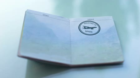 иностранец : Welcome to Spain, customs officer hand stamping seal in passport, travel