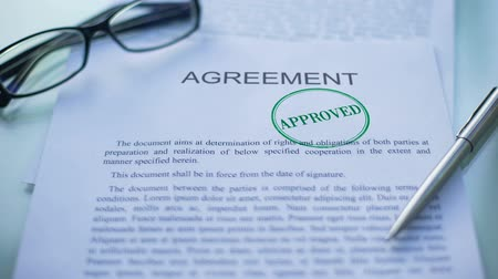 notarize : Agreement approved, officials hand stamping seal on business document, close up Stock Footage