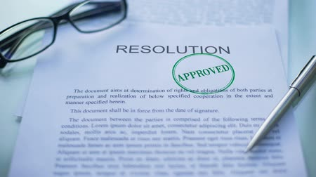 important : Resolution approved, officials hand stamping seal on business document Stock Footage